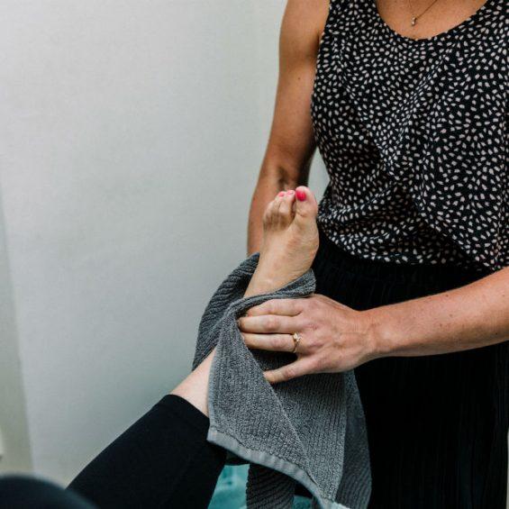 Sports osteo massaging ankle strain