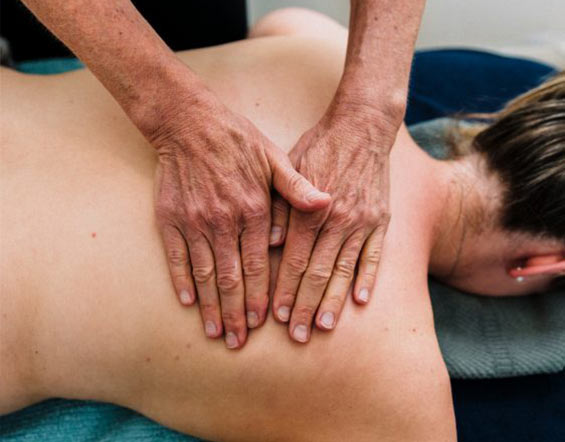 Osteopath applying pressure to Melbourne adult's back