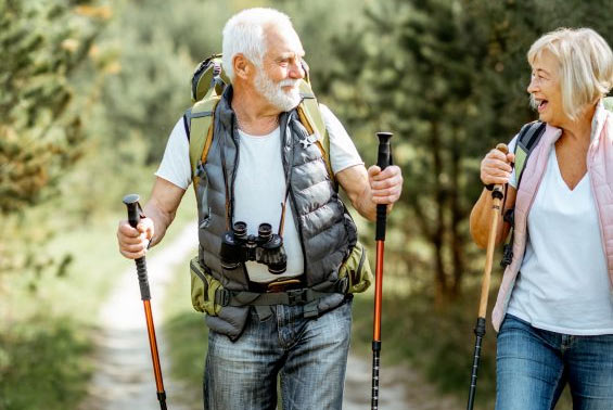 Healthy seniors tramping and smiling after Osteopathy