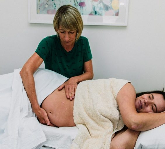 Aromatherapy massage on pregnant women's belly