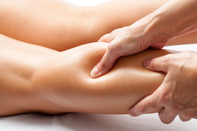Osteopathic massage on calf muscles
